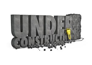 44854987 - under construction stone 3d render of under construction text cut from stone block with jackhammer